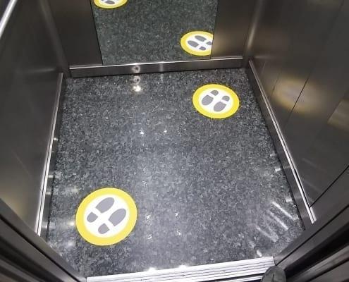 vinilos suelo ascensor anticoronavirus